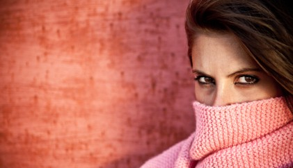 woman using scarf to cover mouth