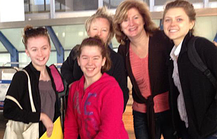Dr. Jill Smith and family in front of an airport