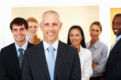 Portrait of confident multi racial business people smiling together at office