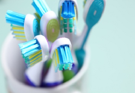 several toothbrushes in cup