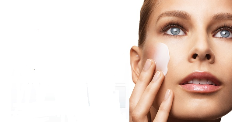 woman rubbing beauty cream on face while looking up